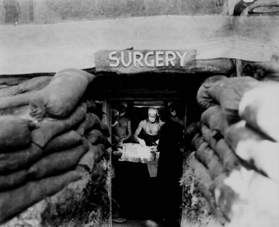 "(The late 1940s) ""Hero surgeons"" + plastic = big advances. The years following World War II saw a huge increase of new biomaterials and techniques for using them. Buddy Ratner attributes this to two factors. Firstly, that surgeons on the battlefield were given carte blanche to try new things to save their patients, and many of these so-called ""hero surgeons"" got creative. Secondly, plastics became widely available. ""It was a seminal moment,"" says Ratner. ""During the war, many of the plastics we take for granted were considered war necessities … Once the war was over and these were released, physicians saw a couple of very obvious reasons why plastics would be good. They're a lot easier to fabricate into shapes than metal. Plastics are light, and they have this wonderful quality of inertness."" Shown here, an American Army doctor operates on a U.S. soldier wounded by a Japanese sniper in an underground surgery room, behind the front lines on Bougainville island, December, 1943. Image courtesy US National Archives."
