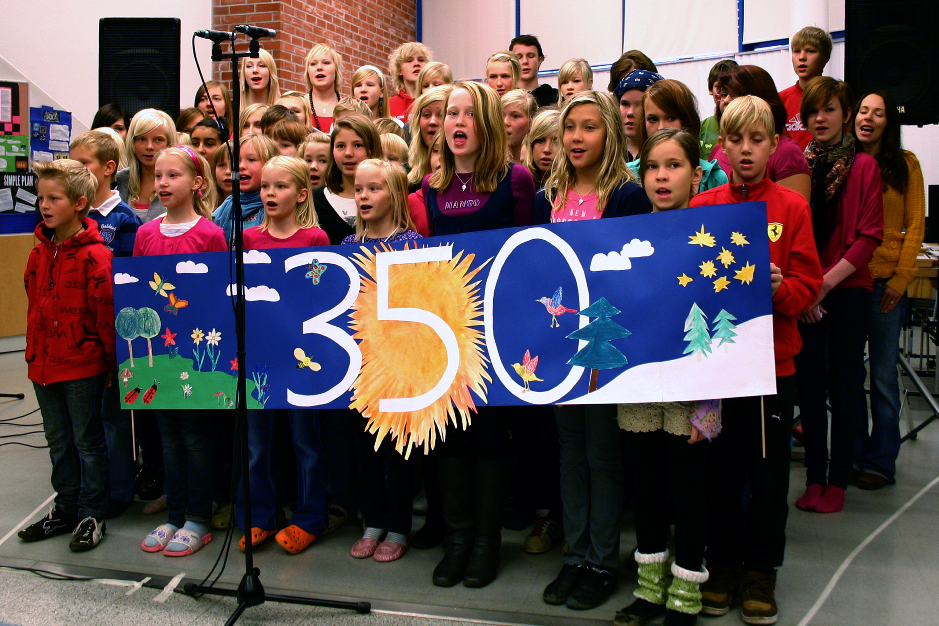 """Children in a Finnish school choir perform a song called """"The Time Is Now"""" on their Climate Action Day. Photo by Aapo-Lassi Kankaala/Flickr. https://www.flickr.com/photos/350org/4040191008"""