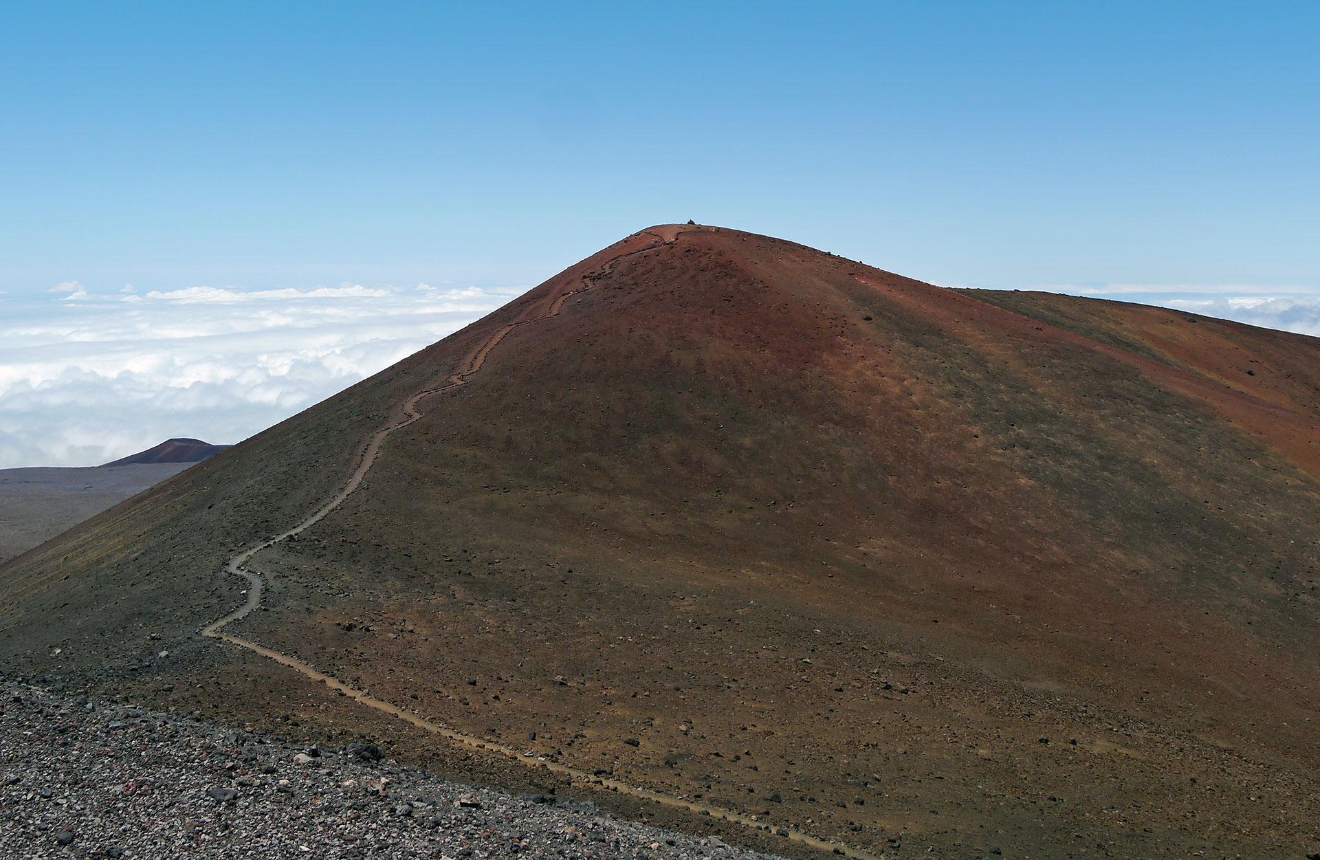 Mauna Kea Trail to the summit of Mauna Kea, Big Island, Hawaii. The cinder cone that is the highest point (13,796 feet) is called Pu'u Wekiu.