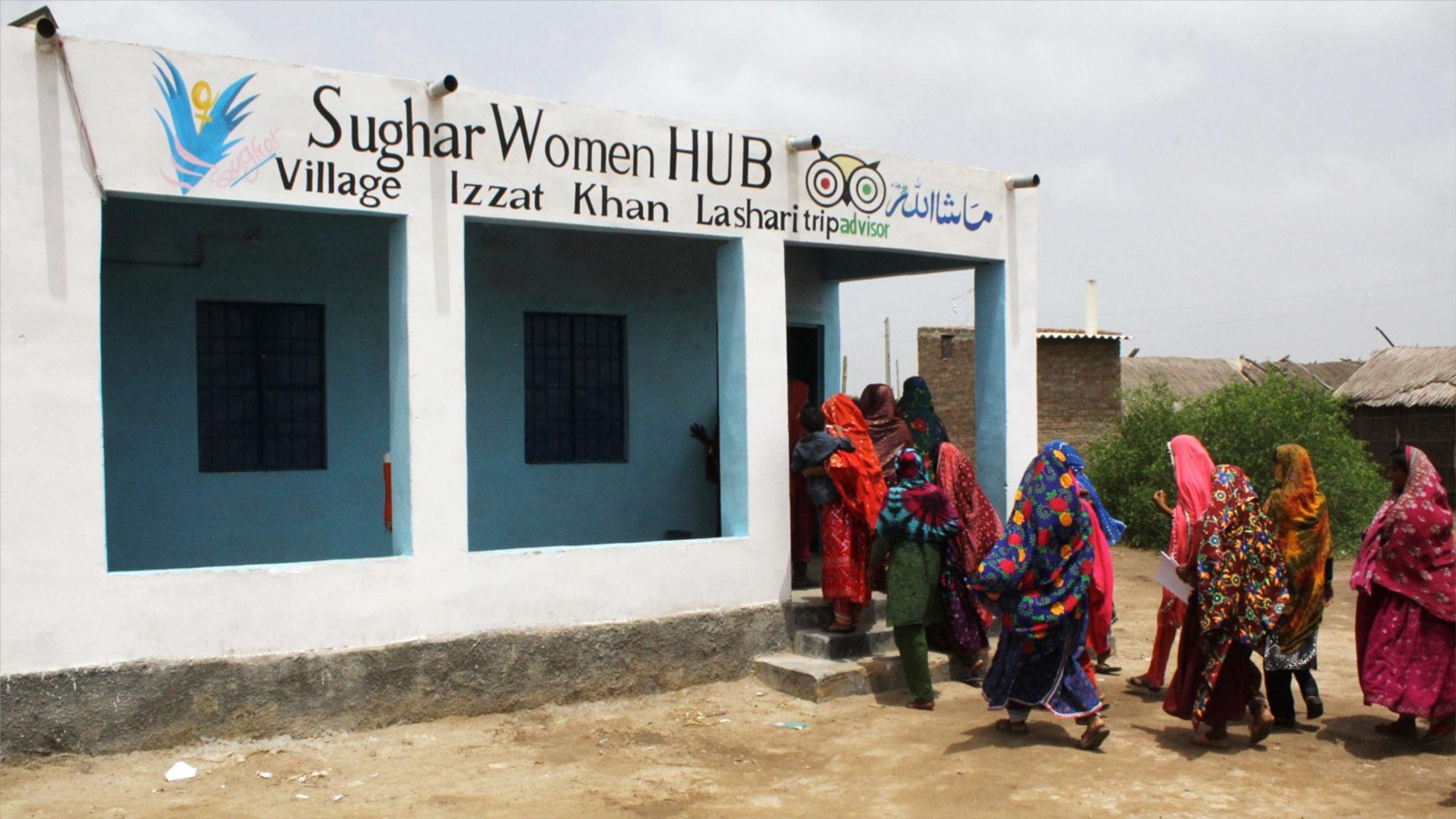 Women enter a Sughar Center.