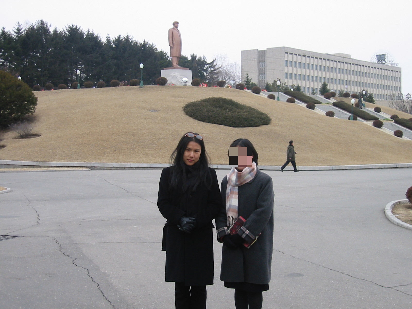 This photograph was taken with a North Korean student at Kim Il-sung University campus. Note the statue of Kim Il-sung, who ruled North Korea from 1948 until his death in 1994.