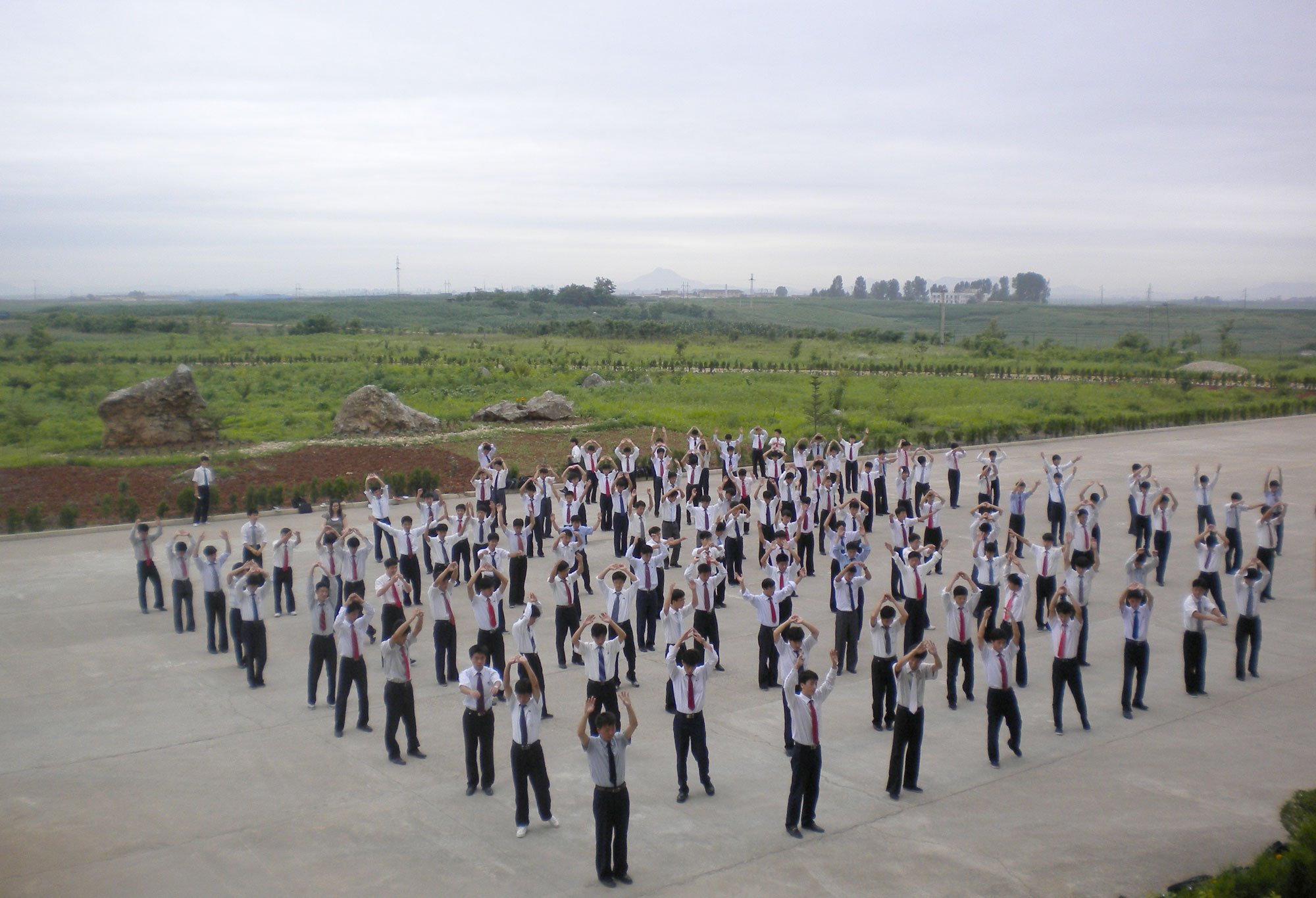 I taught about 270 young men at the university; here are some of the students doing morning exercises.