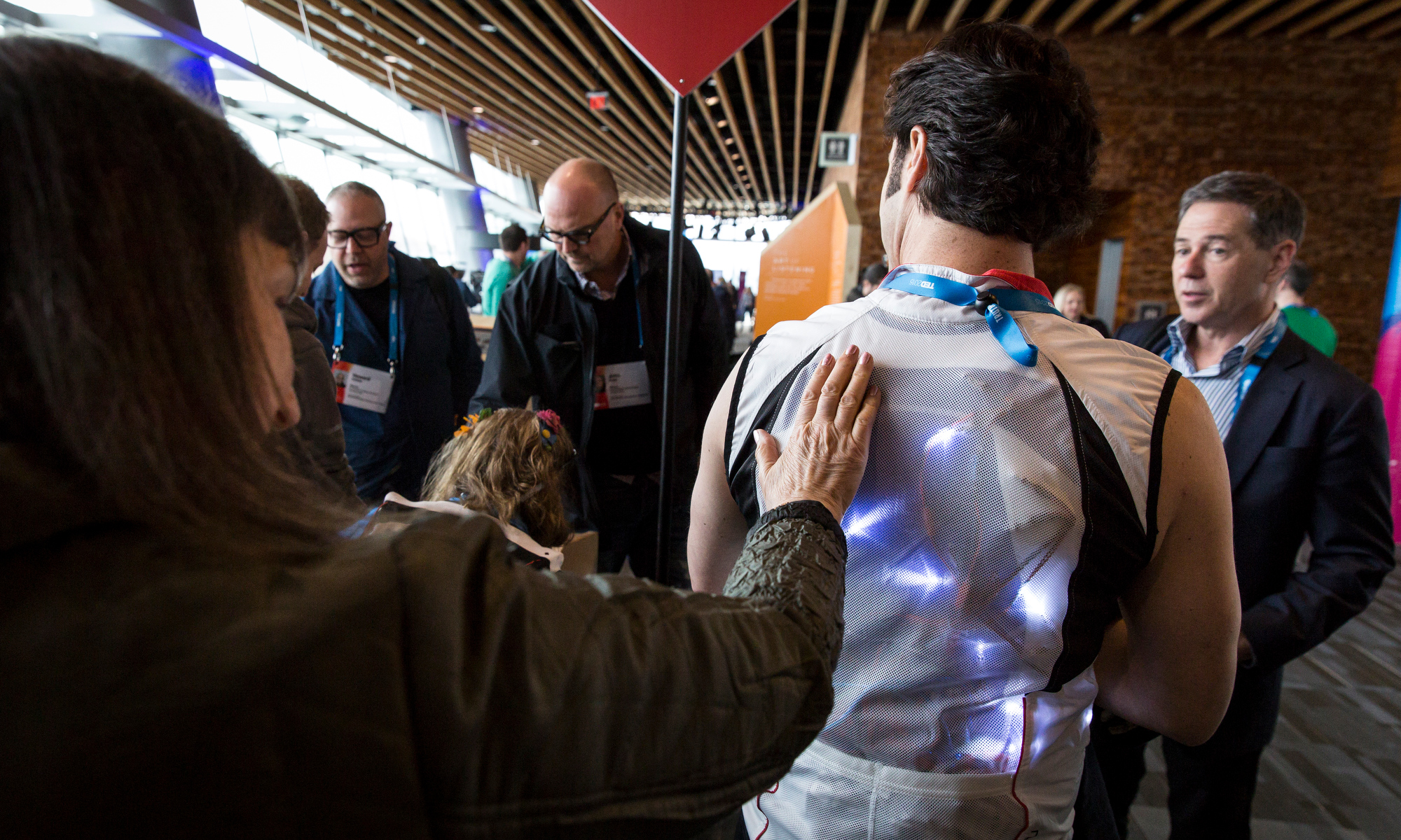 Attendees get a hands-on look at David Eagleman's vest at TED2015 - Truth and Dare, Session 2, March 16-20, 2015, Vancouver Convention Center, Vancouver, Canada. Photo: James Duncan Davidson/TED