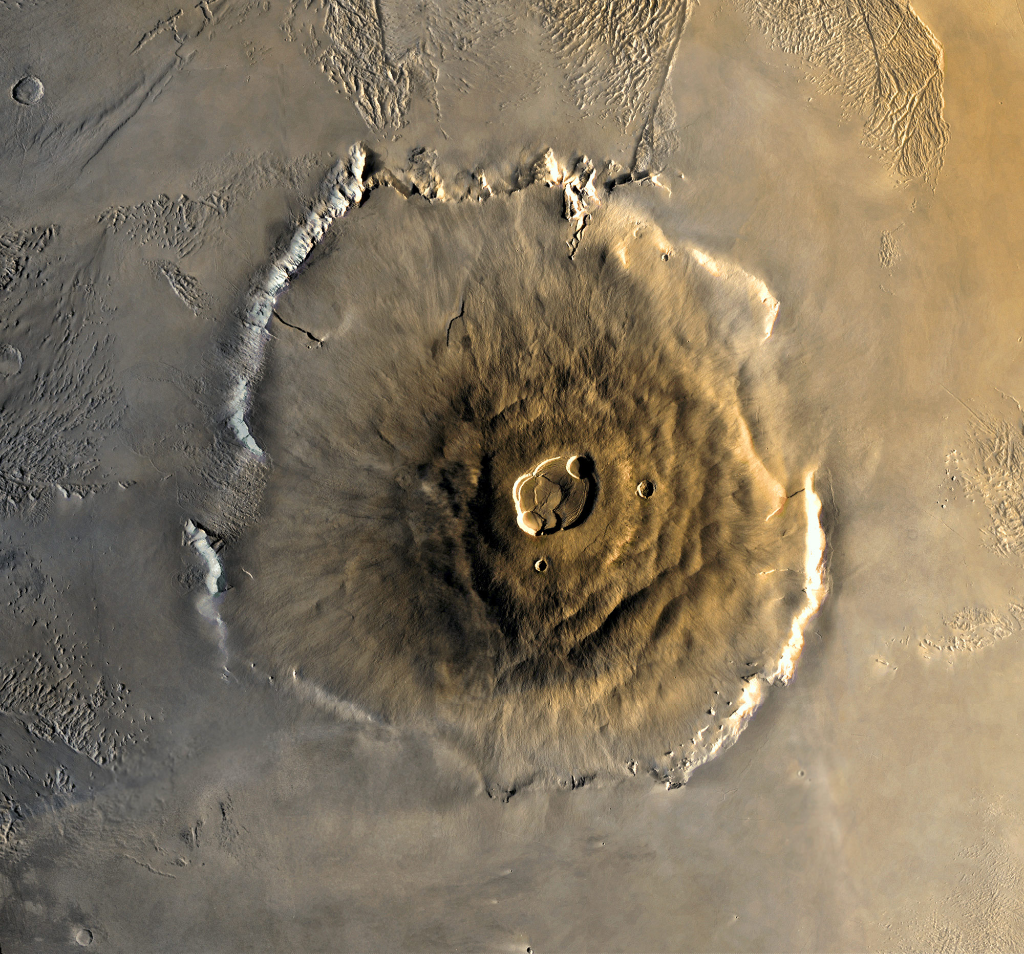 "Photo: NASA/JPL. ""The tallest known volcano and mountain in the solar system, Olympus Mons."""