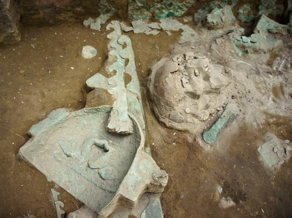 A funerary mask of copper is uncovered near the priestess-queen's skull. Photo courtesy of Luis Jaime Castillo Butters.