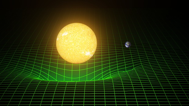 How our sun and Earth warp space and time, or spacetime, is represented here with a green grid. As Albert Einstein demonstrated in his theory of general relativity, the gravity of massive bodies warps the fabric of space and time—and those bodies move along paths determined by this geometry. His theory also predicted the existence of gravitational waves, which are ripples in space and time. These waves, which move at the speed of light, are created when massive bodies accelerate through space and time. Image courtesy T. Pyle/Caltech/MIT/LIGO Lab