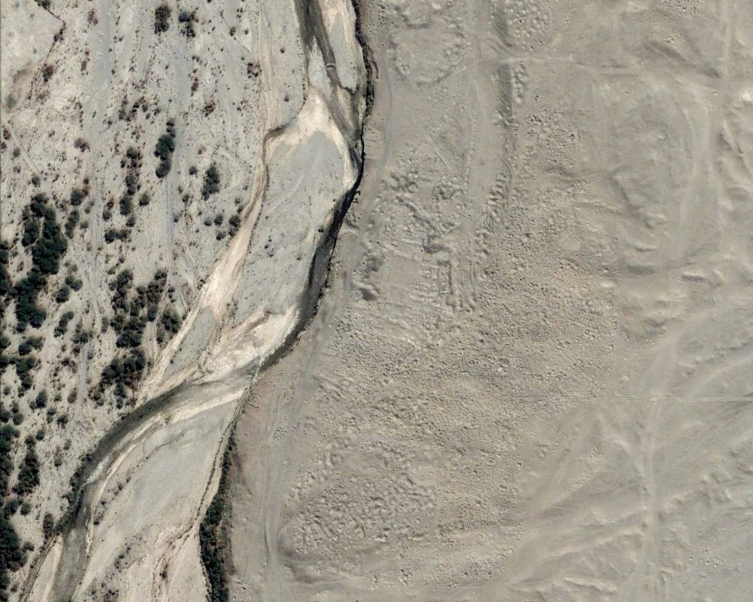 A looted town in the Nazca Dessert. Image copyright Digital Globe.