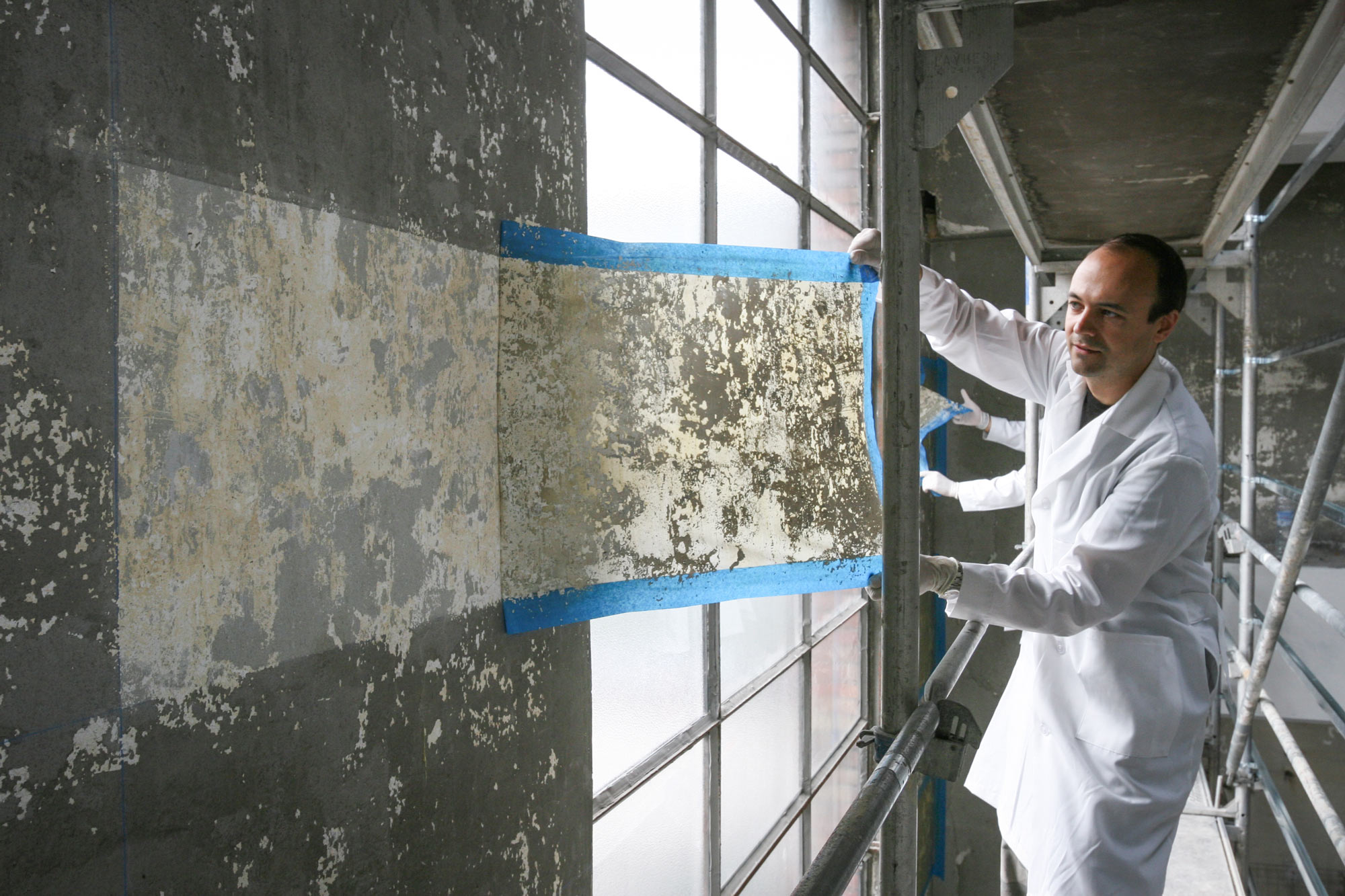 Jorge Otero-Pailos cleaning the wall of the Alumix factory in 2008. (photo courtesy of Patrick Ciccone)